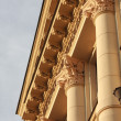 Fragment of neoclassic building with columns and fine capitals. — Stock Photo #42008321