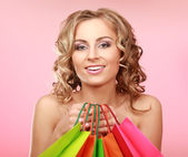 Woman happy holding shopping bags — Stock Photo