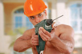 Construction worker with hand drill — Stock Photo