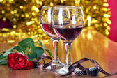 Romantic dinner with wine glasses — Stock Photo