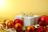 Christmas balls and a gift — Stock Photo
