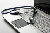 A stethoscope on a white laptop — Foto de Stock