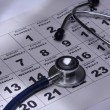 Stethoscope over a calendar — Stock Photo