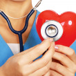 Stethoscope examining red heart — Stock Photo