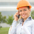 Woman architects calling by mobile phone — Stock Photo