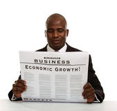 African American businessman reading a newspaper — Stockfoto