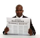 African American businessman reading a newspaper — Stok fotoğraf