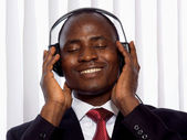 Afro-American businessman with headset — Stock Photo