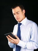 Young adult working on a digital tablet — Stock Photo