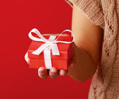 Female hand holding gift box — Stock Photo