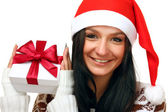 Sexy santa claus clothes with a gift — Stock Photo