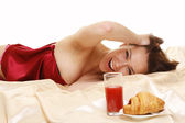 Woman in bed with breakfast — Stock Photo