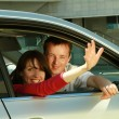 Young couple in the car — Stock Photo #41148969