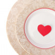 Red heart in plate — Stock Photo