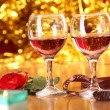 A rose and two glasses — Stock Photo