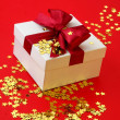 Stock Photo: Gift on gold stars