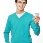 Молодой парень с мобильного телефона — Стоковое фото #41148891