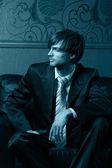 Handsome businessman sitting — Stock Photo