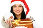 Santa costuemed girl holding giftbox — Stock Photo