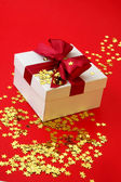 Gift on gold stars — Stock Photo