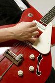 Closeup of a guitarist playing — Stock Photo