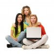 Three girls with a laptop — Stock Photo #41151483