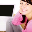 Young woman sitting with laptop — Stock Photo #41151569