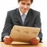Businessman reading newspaper — Stock Photo #41152511