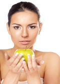 Young woman with a green apple — Stock Photo
