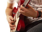 Close-up of a guitar and playing hands — Stock Photo