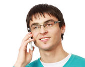 Young guy speaking on cellphone — Stock Photo