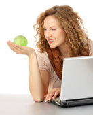 Woman with laptop and Globe in the hand — Stockfoto