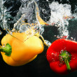 Red and yellow peppers in water — Stock Photo #41176335