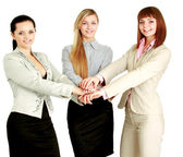 Businesswomen  putting their hands — Stock Photo