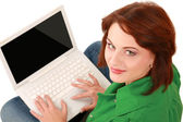 Woman with a laptop sitting on the floor — Stock Photo