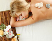 Woman relaxing during a spa stone therapy — Stock Photo