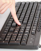 Woman's hand on keyboard — Stock Photo