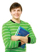 Young college guy holding books — Stock Photo