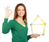Woman holding a ruler and showing ok — Stock Photo