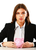 Woman sitting with piggy bank — Stock Photo
