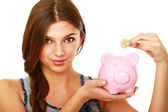 Woman standing with piggy bank — Stock Photo