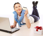 Woman  with a laptop,credit card  and a gift box — Photo