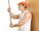 Construction worker near wall — Stock Photo