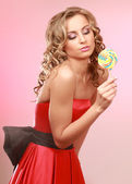 Happy woman with lollipop — Stock Photo