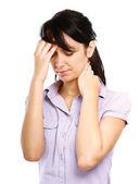 Junge Frau mit Kopfschmerzen — Stockfoto
