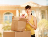 Woman with box moving — Stock Photo