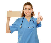 Doctor with an empty blank and thumb up sign — Stock Photo