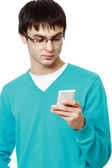 Young guy with a mobile phone — Stock Photo