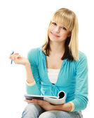 College girl with a pen and a textbook — Stock Photo