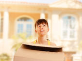 Girl with a box outside — Stock Photo